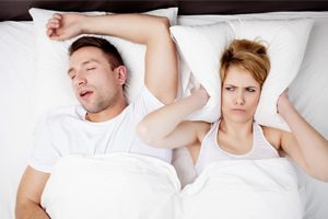 Man Snoring Wife Covering Ears